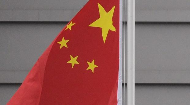 Police are hunting for a man in northeast China suspected of killing 10 people (AP)