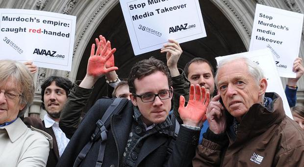 Demonstrators outside the High Court in London (PA)