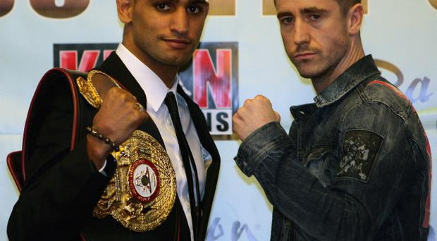 Amir Khan and Paul McCloskey (right) during a press conference in The Grand Hall at Manchester Town Hall, Manchester