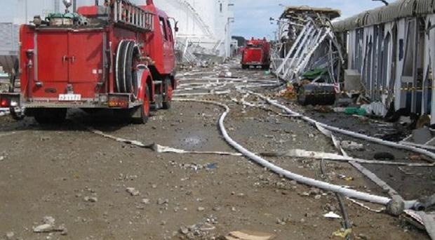 Fire engines at the debris-strewn compounds of the tsunami-stricken Fukushima Dai-ichi nuclear power plant in northeastern Japan (AP)