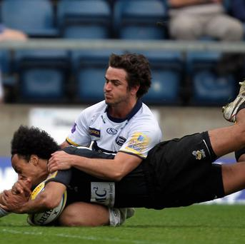 Wasps' Richard Haughton beats the tackle of Leeds' Peter Wackett to score their third try during the Aviva Premiership match at Adams Park, High Wycombe. PRESS ASSOCIATION Photo. Picture date: Sunday April 17, 2011. Photo credit should read: David Davies/PA Wire.