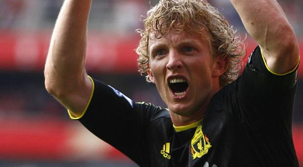 Liverpool's Dirk Kuyt celebrates after scoring his team's opening goal during the Barclays Premier League match at the Emirates Stadium
