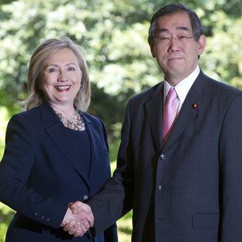 Japanese Foreign Minister Takeaki Matsumoto shakes hands with US Secretary of State Hillary Clinton in Tokyo (AP)