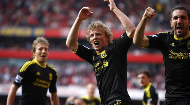 Liverpool's Dirk Kuyt (centre) celebrates after scoring his team's opening goal during the Barclays Premier League match at the Emirates Stadium, London.