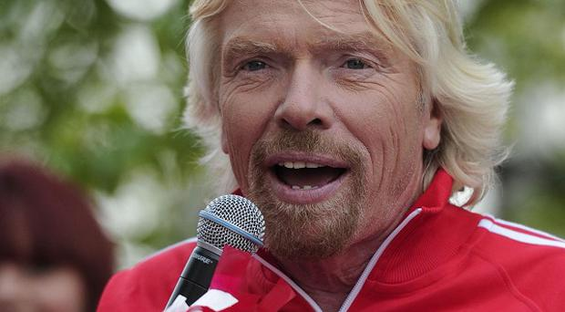 Sir Richard Branson is willing to have his legs shaved