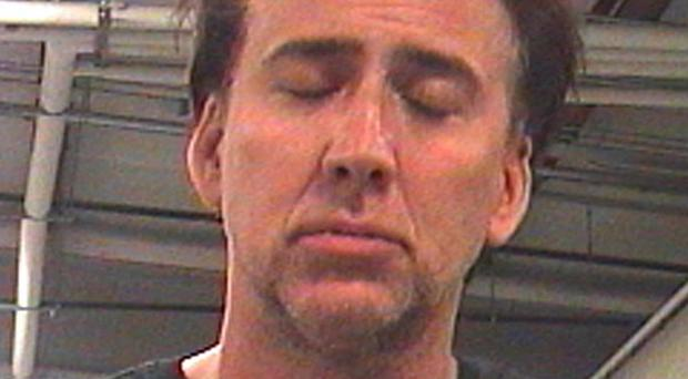 A photo released by Orleans Parish Sheriff's Office shows actor Nicolas Cage after his arrest in New Orleans (AP)