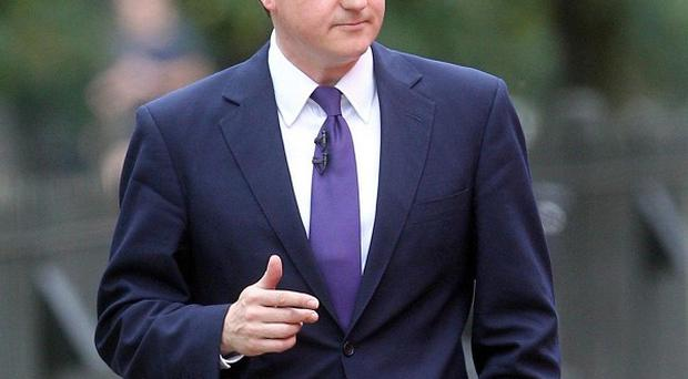 David Cameron is to break with tradition by wearing a lounge suit when he attends the royal wedding