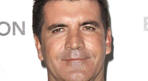 X Factor supremo Simon Cowell will not be 'a weekly judge' on the new series of the show
