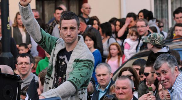 Dungiven boxer Paul McCloskey with his son Cian, who was welcomed home by thousands of people in Dungiven