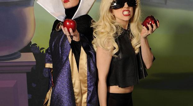 Lady Gaga posed with Snow White's Evil Queen at the Magic Kingdom park at Walt Disney World Resort in Florida