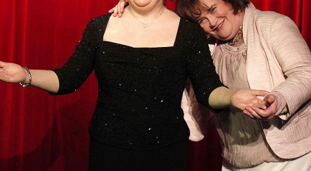 Britain's Got Talent star Susan Boyle poses alongside her waxwork at Madame Tussauds in Blackpool