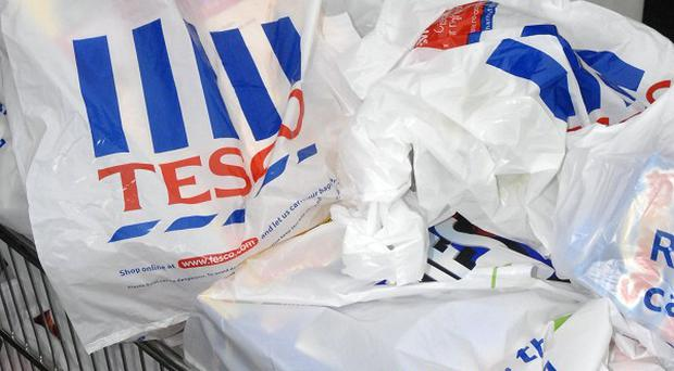 Supermarket giant Tesco has revealed a fourth-quarter sales slump, but still had a record profits rise