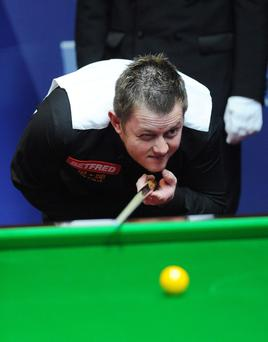 Mark Allen, lining up a pot against Matthew Stevens last night at the Crucible, resumes tonight 5-4 behind