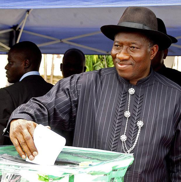 Incumbent president Goodluck Jonathan casts his ballot in Otuoke, Nigeria (AP)