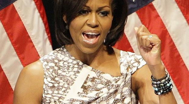 A plane carrying Michelle Obama had to abort a landing after coming too close to a military jet, officials said (AP)