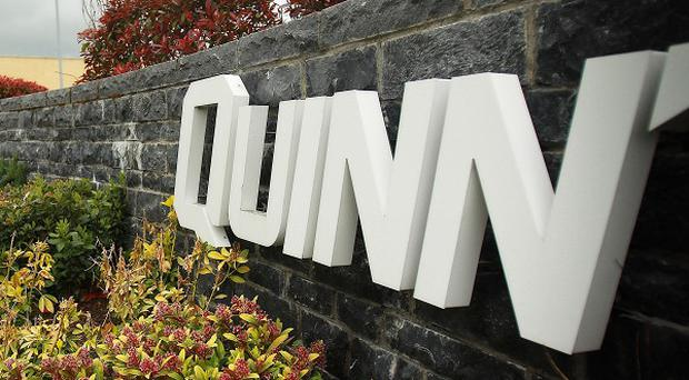 A large dumper truck has been abandoned across the entrance to the Co Fermanagh headquarters of the Quinn Group