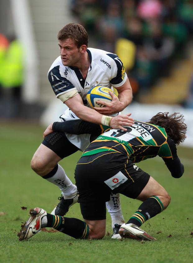 Mark Cueto, in action at the weekend, escaped lightly after gouging Christian Day