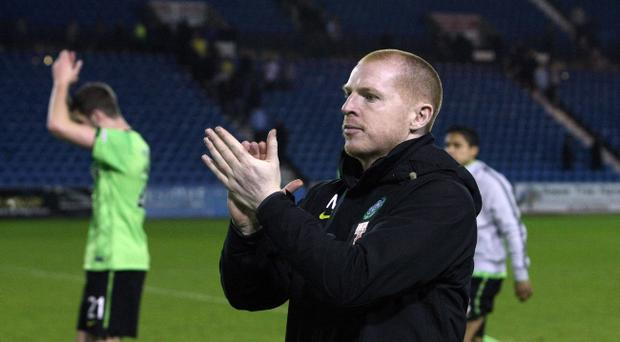 Celtic manager Neil Lennon celebrates after the Clydesdale Bank Premier League match between Kilmarnock and Celtic at Rugby Park on April 20, 2011 in Kilmarnock, Scotland