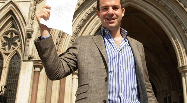 Martin Lewis, from MoneySavingExpert.com, celebrates the ruling in PPI sales