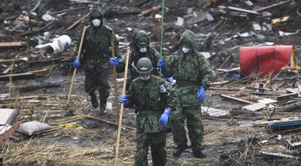 Authorities are considering restricting access to the evacuation zone around Japan's crippled nuclear plant (AP)