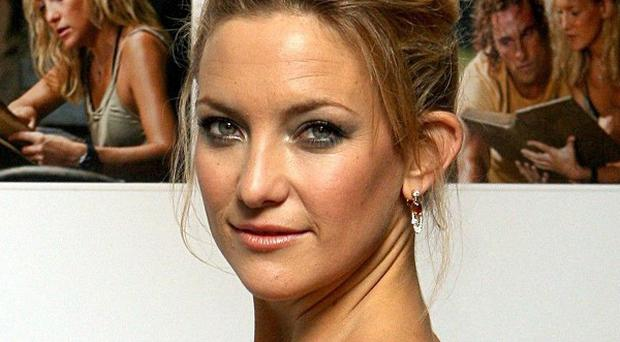 Kate Hudson says happiness is her secret to looking good