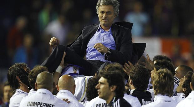 VALENCIA, BARCELONA - APRIL 20: Head Coach Jose Mourinho of Real Madrid celebrates after the Copa del Rey final match between Real Madrid and Barcelona at Estadio Mestalla on April 20, 2011 in Valencia, Spain. Real Madrid won 1-0. (Photo by Manuel Queimadelos Alonso/Getty Images)
