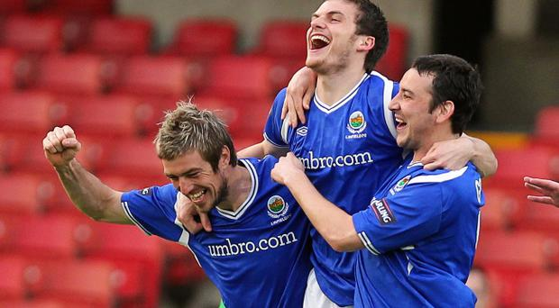 Philip Lowry's brace against Glentoran blasted the Blues to the brink of another title