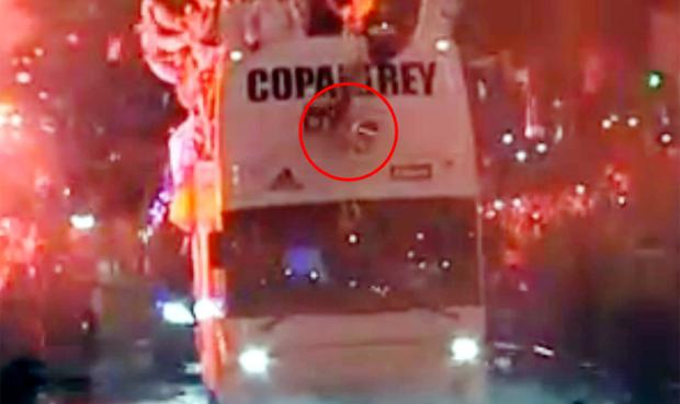 The Copa del Ray falls from the front of the Real Madrid team bus after being dropped by Sergio Ramos