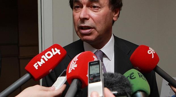 Justice Minister Alan Shatter has said bailed-out bankers may not be legally entitled to massive bonuses