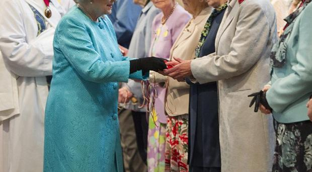 The Queen distributes Maundy Money during the traditional Royal Maundy Service at Westminster Abbey