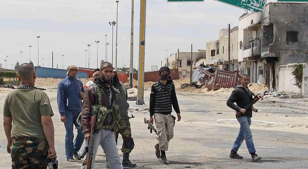 Libyan rebel fighters in the besieged city of Misrata (AP)