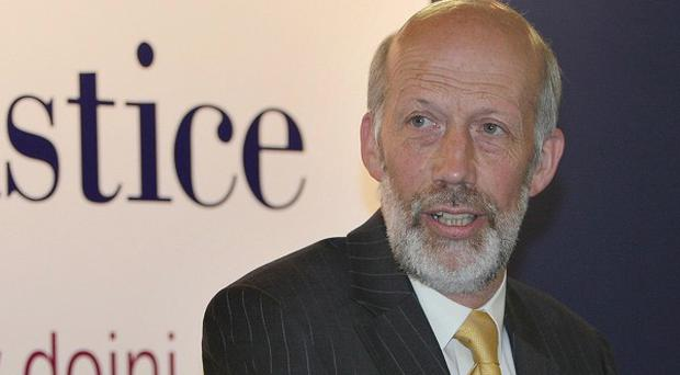 Justice Minister David Ford has announced a probe into claims Government officials interfered in the Police Ombudsman's work