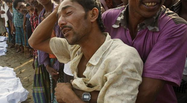 Bangladeshi Din Islam weeps over loss of his children and wife in a ferry accident in Brahmanbaria (AP)