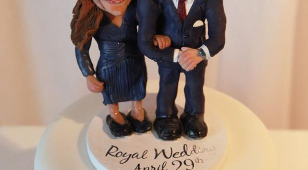 A cake featuring figurines of Prince William and Kate Middleton is displayed at an exhibition of Royal Wedding cakes on April 21, 2011