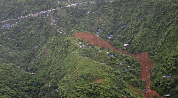 An aerial view of the landslide that hit a mining camp in the Philippines (AP)