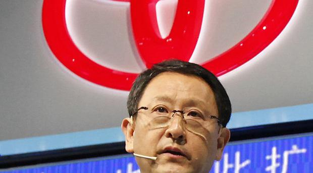 Toyota president Akio Toyoda said global car production will not return to normal until November or December (AP)