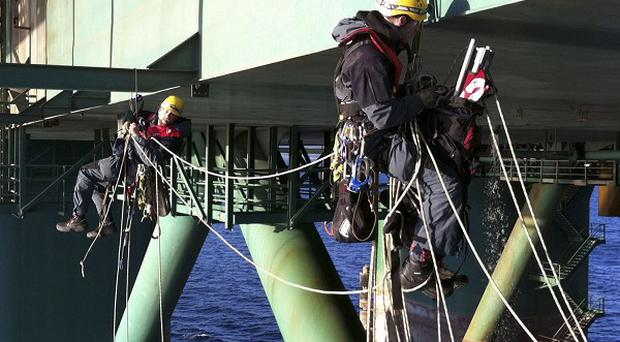 Greenpeace activists climbed aboard the oil rig Leiv Eiriksson to prevent its departure for Greenland (AP)
