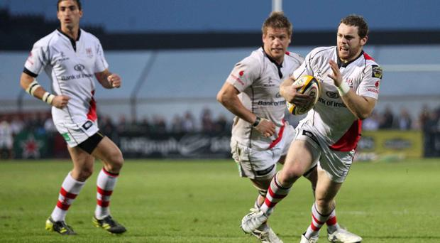 Ulster's Darren Cave runs in a try during Friday night's Magners League clash at Ravenhill