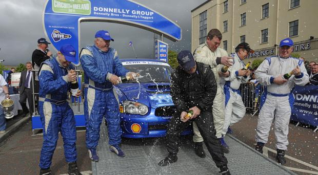 Derek McGarrity celebrates his fifth win in the Donnelly Group Circuit of Ireland rally