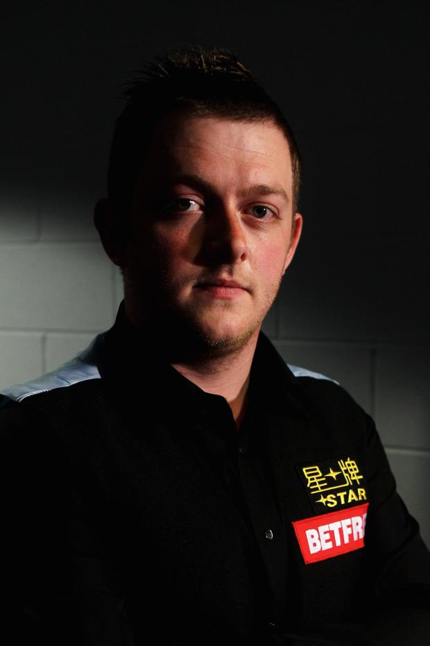 SHEFFIELD, ENGLAND - APRIL 23: Mark Allen of Northern Ireland poses after victory in his round two game against Barry Hawkins of England on day eight of the Betfred.com World Snooker Championship at The Crucible Theatre on April 23, 2011 in Sheffield, England. (Photo by Dean Mouhtaropoulos/Getty Images)