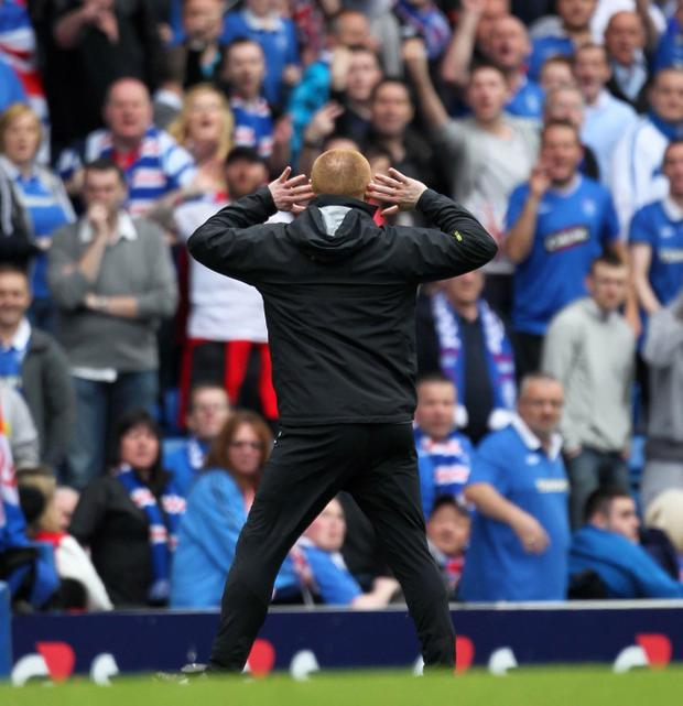 Neil Lennon gestures towards the Rangers fans at Ibrox