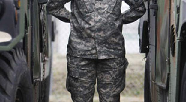 Major Sequana Robinson models the US Army's new women's combat uniform