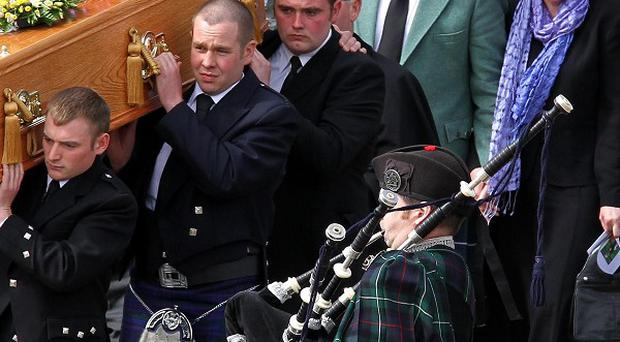 David and Katie Taylor follow the coffin of their daughter Sophie from the Lecht Ski centre where her funeral was held