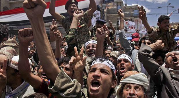 Forces loyal to Yemen's president have opened fire on protesters demanding his removal (AP)