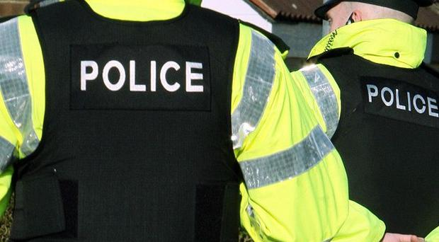 Two women have been arrested by police investigating the murder of a man in Co Down