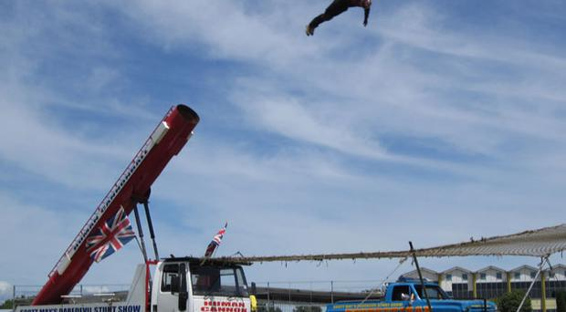 The illusion of an explosion is created using firecrackers and smoke machines when the human cannonball is fired