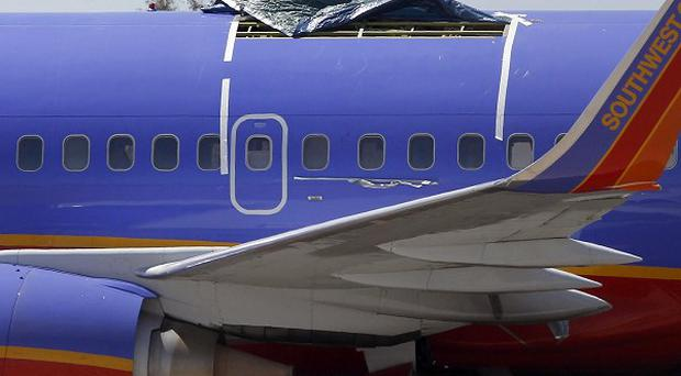 A Southwest Airlines jet had a section of fuselage tear from the plane during a flight on April 1 (AP)