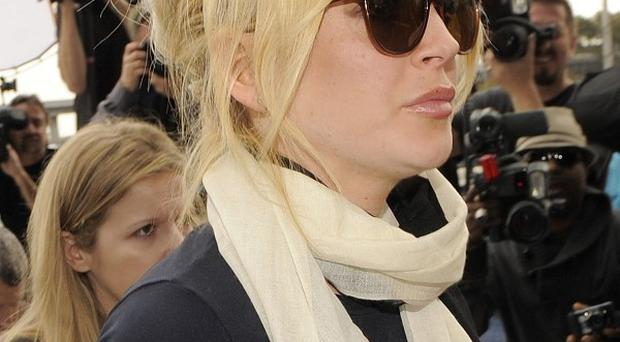 Lindsay Lohan arrives at LAX Courthouse in Los Angeles (AP)