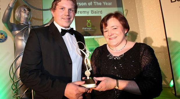 Jeremy Baird is presented with the Best Young Business Person of the Year award at Belfast Business Awards by Professor Marie McHugh