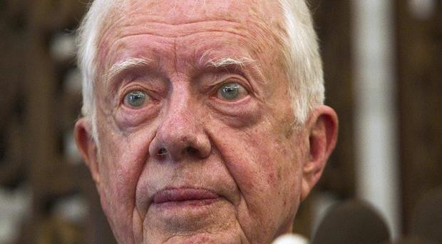 Former US president Jimmy Carter is in North Korea for talks (AP)